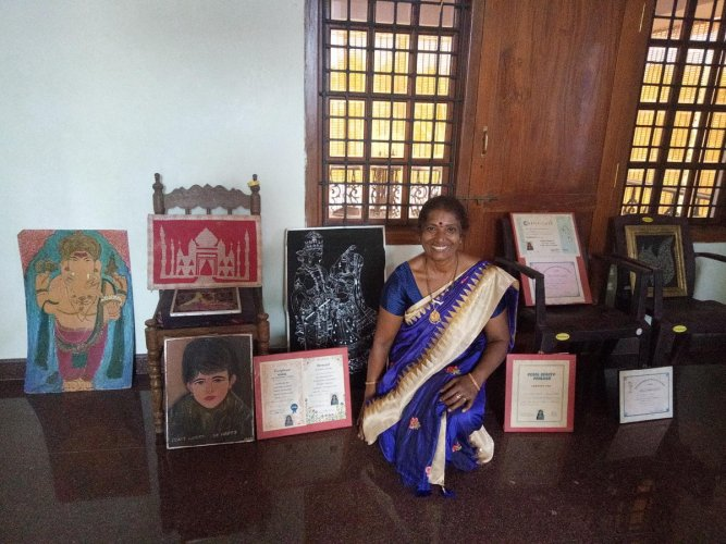 Sudha S Shetty with her many art works and certificates won by her.
