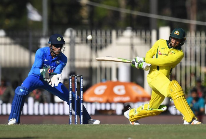Australian cricketer Usman Khawaja (R) plays a shot during the third one-day international (ODI) cricket match between India and Australia at the Jharkhand State Cricket Association International Cricket Stadium, in Ranchi. AFP photo