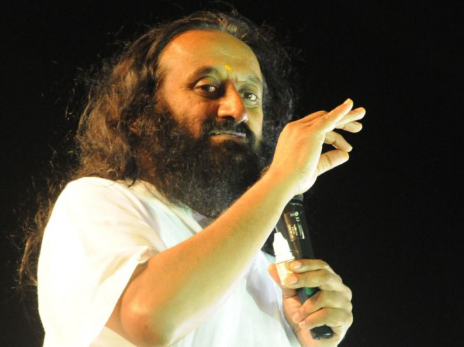 """""""We must all move together towards ending long-standing conflicts happily by maintaining harmony in society,"""" Sri Sri Ravishankar said. (DH File Photo)"""
