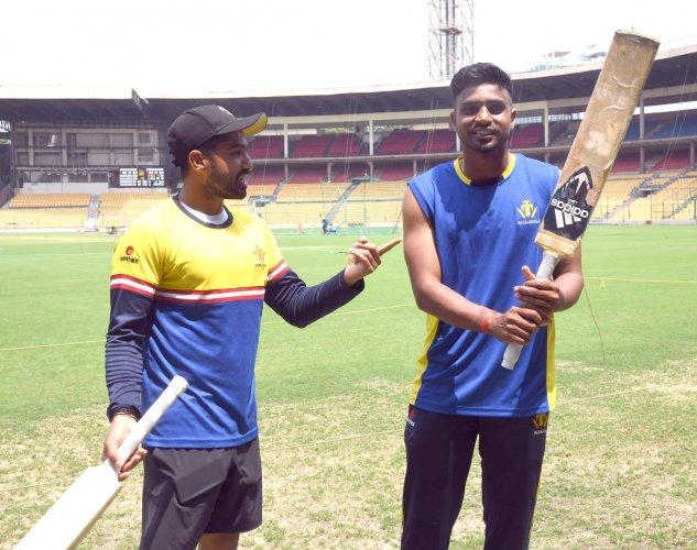 Rohan Kadam (right) slammed 45-ball unbeaten 62 in Karnataka's nine-wicket win over Mumbai. DH PHOTO