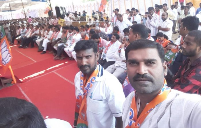 A BJP worker takes a selfie during the meeting of Shakthi Kendra Pramukhs, on JK Grounds in Mysuru on Wednesday.