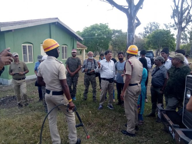 Fire and Emergency Services personnel demonstrate techniques of firefighting, at Bandipur on Thursday. Adjunct faculty at Karnataka Forest Academy, also retired assistant conservator of forests, S Chandrashekar is seen.
