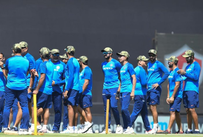Indian cricketers wear camouflage army caps ahead of the third one-day international (ODI) cricket match between India and Australia at the Jharkhand State Cricket Association International Cricket Stadium in Ranchi. AFP