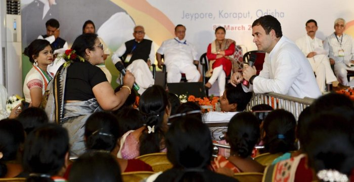 Congress President Rahul Gandhi interacts with a woman at a convention, in Jeypore town of Koraput. PTI