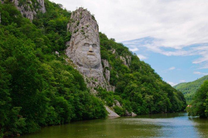 Carved portrait of Dacian king Decebal on Danube river.