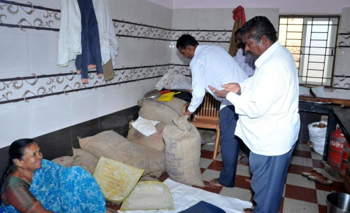 Zilla Panchayat Standing Committee on Social Justice president Hirigayya inspects the food grains at a hostel in Chikkamagaluru.