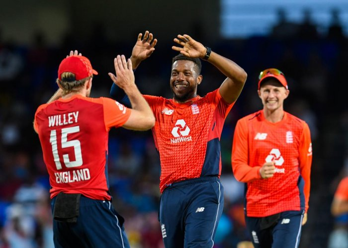 WRECKER IN CHIEF: England's Chris Jordan (centre) celebrates with team-mates after dismissing Nicholas Pooran of West Indies. AFP