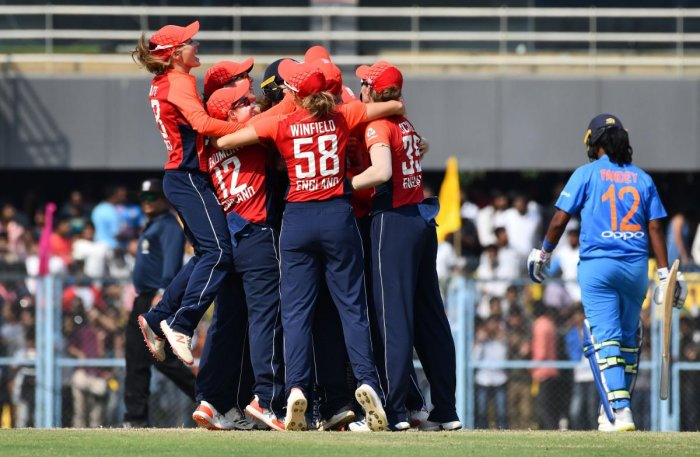 England's players celebrate after winning the final match of the women's Twenty20 (T20) cricket series between India and England at the Barsapara Cricket Stadium in Guwahati. AFP photo