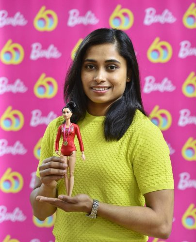 Star gymnast Dipa Karmakar with one-of-a-kind doll presented to her to commemorate Barbie's 60th anniversary in New Delhi on Saturday. PTI