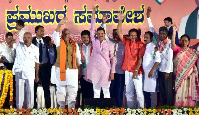 Union Home Minister Rajnath Singh, State BJP President B S Yeddyurappa, MPs Nalin Kumar Kateel, Shobha Karandlaje and others wave at crowd during convention of Shakthi Kendra Pramukhs at Nehru Maidan in Mangaluru on Saturday.