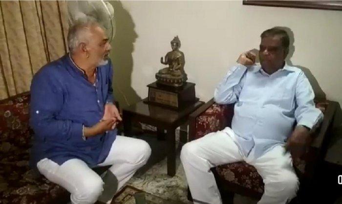Former minister A Manju meets state vice president of BJP Srinivas Prasad in Mysuru on Saturday.