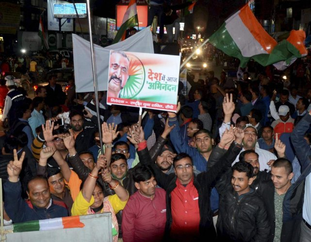 Ranchi: BJP workers jubilate after the release of IAF pilot Wing Commander Abhinandan Varthaman by Pakistan, in Ranchi, Friday, March 1, 2019. Varthaman was captured by Pakistan after his jet went down following a strike by an enemy missile. (PTI Photo)