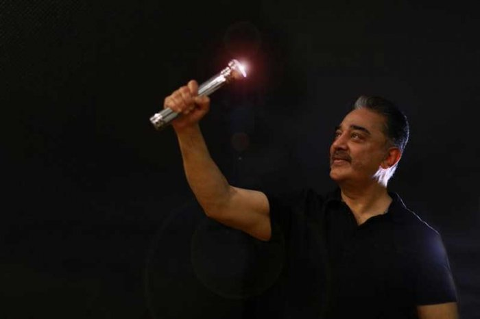 Kamal Haasan with his party symbol ' Battery Torch' (Picture: Makkal Needhi Maiam)