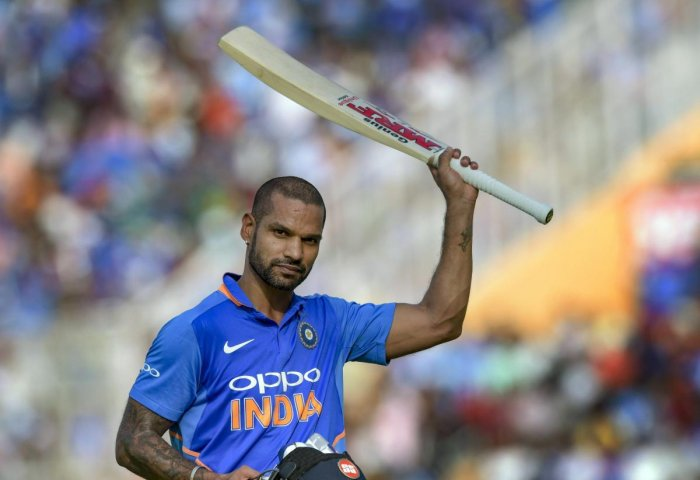 India's Shikhar Dhawan reacts as he returns after his dismissal on 143 during the 4th ODI cricket match against Australia in Mohali, Sunday. PTI photo