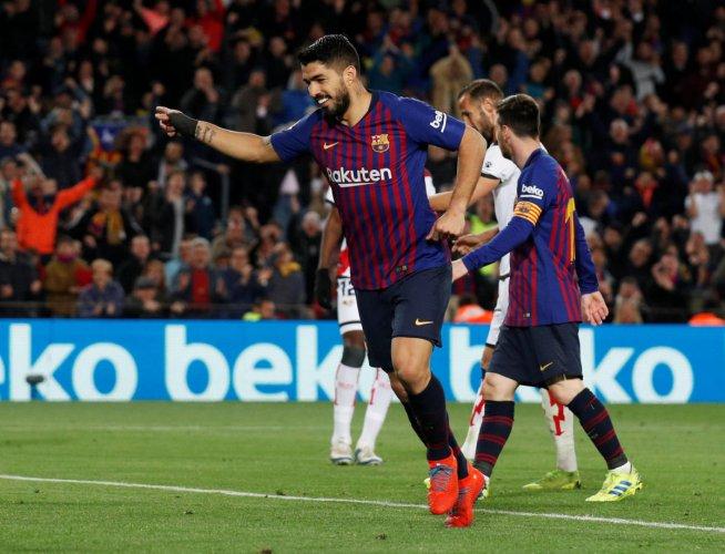 MERCURIAL: Barcelona's Luis Suarez celebrates scoring their third goal against Rayo Vallecano. Reuters