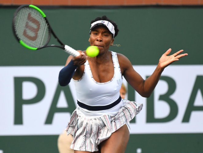 GUTSY: Venus Williams of the US returns during her win over Petra Kvitova of Czech Republic at the Indian Wells Masters.