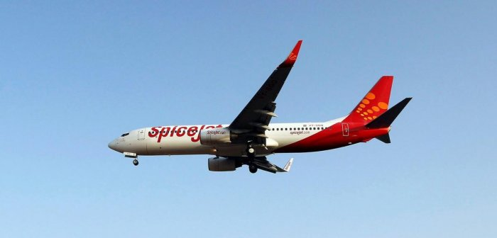 FILE PHOTO: A SpiceJet passenger aircraft prepares to land at Sardar Vallabhbhai Patel international airport in Ahmedabad, India May 19, 2016. REUTERS/Amit Dave/File Photo