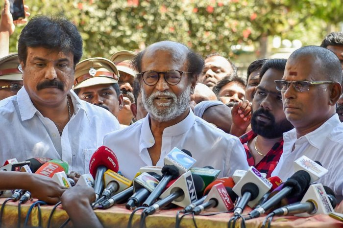 Actor-turned-politician Rajinikanth addresses the media after meeting DMDK chief Vijayakanth at his residence in Chennai onFriday. (PTI Photo)