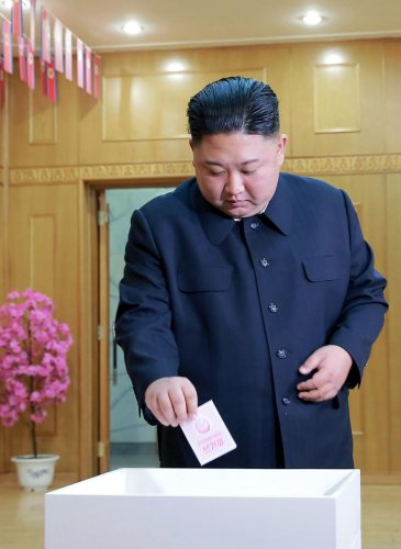 In this picture taken on March 10, 2019 and released from North Korea's official Korean Central News Agency (KCNA), North Korean leader Kim Jong-Un casts his ballot for the Supreme People's Assembly elections, at a polling station in Kim Chaek University