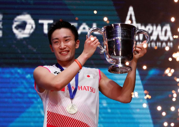 Japan's Kento Momota celebrates with the All England championship trophy after winning men's final against Denmark's Viktor Axelsen. Reuters