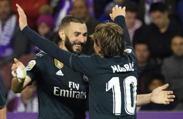 Karim Benzema (left) celebrates with Luka Modric after scoring against Real Valladolid in the La Liga on Sunday. AFP