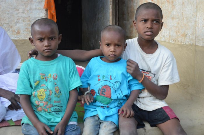 Eleven-year-old Debudoes not allow his two younger brothers--Dilip and Goutam to separate since they lost their parents to toxic liquor on February 21.