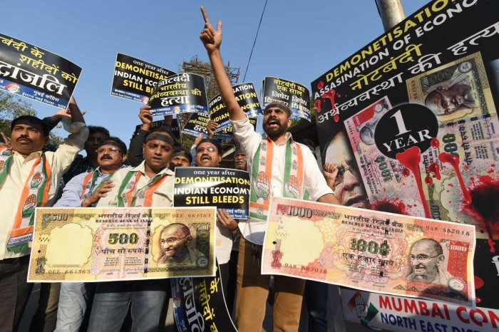 Congress supporters shout slogans and hold placards during a protest on the eve of the first anniversary of demonetisation scheme in Mumbai on November 7, 2017. AFP FILE