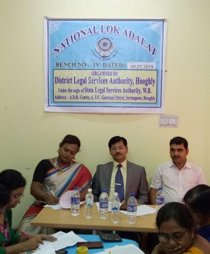 Shintu Baghui ( extreme left) at the recently held Lok Adalat in Hooghly district. DH Photo