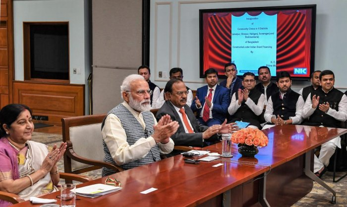Prime Minister Narendra Modi and his Bangladesh counterpart Sheikh Hasina (unseen) jointly inaugurate development projects in Bangladesh through video conferencing, in New Delhi, on Monday. External Affairs Minister Sushma Swaraj and National Security Adv