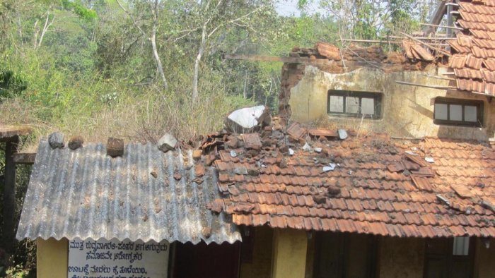 The roof and walls of a building on the premises of the Government Model Primary School in Napoklu have already collapsed.