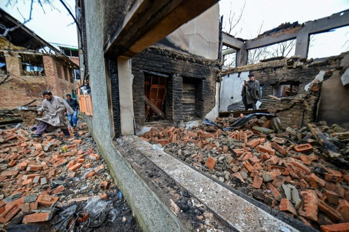 The debris of a destroyed house after a gunfight between security forces and militants at Pinglish area of Tral in Pulwama district of South Kashmir on Monday. PTI