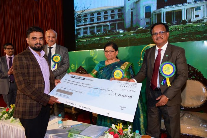 Corporation Bank MD and CEO P V Bharathi handS over cheque under CSR activity to Shivamogga Institute of Medical Sciences towards three haemodialysis machines during the 114th Foundation Day celebrations of the Bank in Mangaluru on Tuesday.