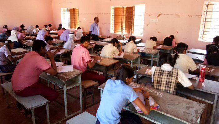 According to the recent government order teachers have to ensure a minimum 60% pass in respective subject failing which their salaries, grant-in-aid and promotions would be withheld. DH File Photo for representation
