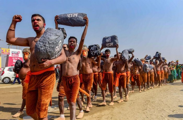 Devotees, dressed up as Ram Sena, take part in a religious procession to press for the construction of the Ram Temple in Ayodhya, during the Kumbh Mela in Prayagraj (Allahabad). PTI
