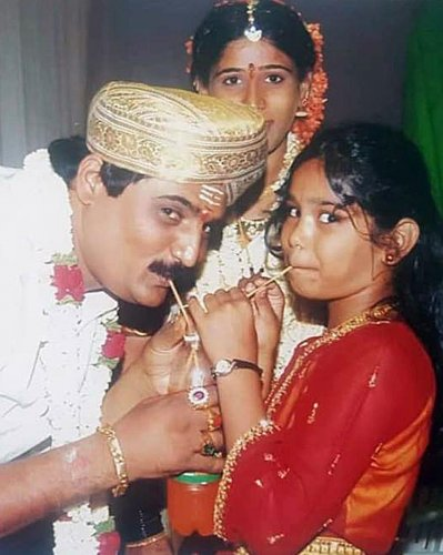 Gangster Lakshmana with Varshini (aged 8) as his wife Chitra looks on.