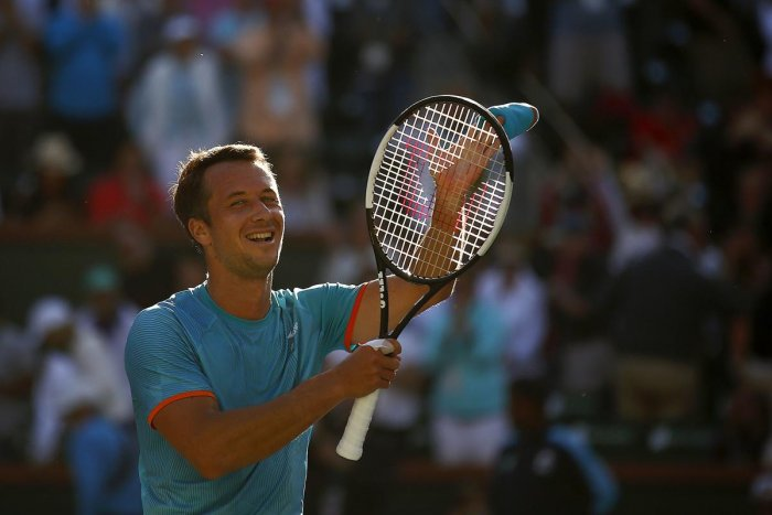 BIG WIN: Philipp Kohlschreiber of Germany celebrates after his third round victory against Novak Djokovic of Serbia. AFP