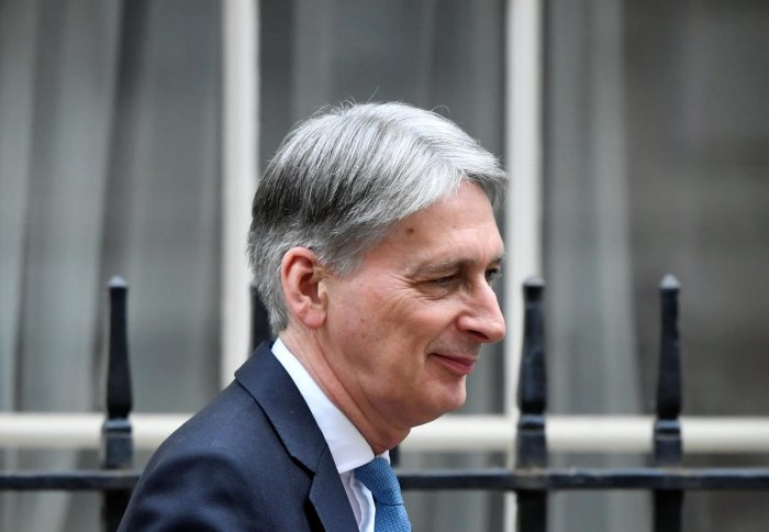 """""""Last night's vote leaves a cloud of uncertainty hanging over our economy and... our most urgent task in this House is to lift that uncertainty,"""" Hammond said in his budget address. (Reuters Photo)"""