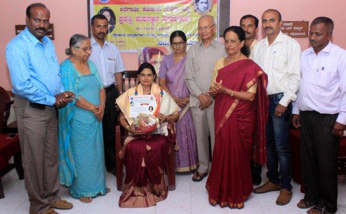 Rashtrakavi Kuvempu's daughter Tarini and writer Chidananda Gowda presented 'Kodagina Gowramma Endowment Award' for the year 2018-19, to Government First Grade College Napoklu principal Dr Kaveri Prakash, in Madikeri on Wednesday.