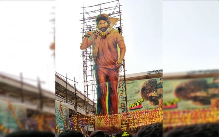 A huge cut out of actor Yash in front of a Cinema in Bengaluru on Friday. (DH Photo/Roshan Nair)