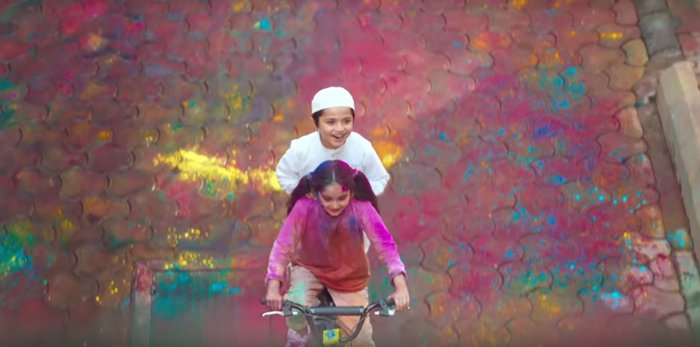 The ad features a young Hindu girl getting drenched in Holi colours to help her Muslim friend reach the mosque for his prayers.