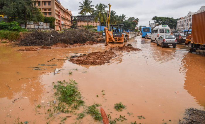 Rainwater floods a road near Meenakshi Temple in Kalena Agrahara, Bannerghatta Road, on Monday. DH Photo/S K Dinesh