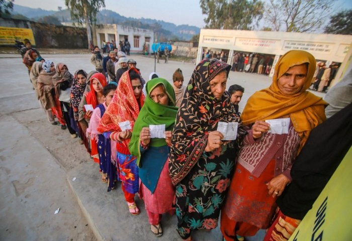 Voters stand in a queue to cast their votes in the 8th phase of Panchayat elections, at Bajalta village in Jammu, on December 8, 2018. PTI