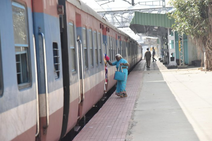 A passenger boarding a DEMU train at Yeswanthapura Junction to go to Devanahalli on Friday