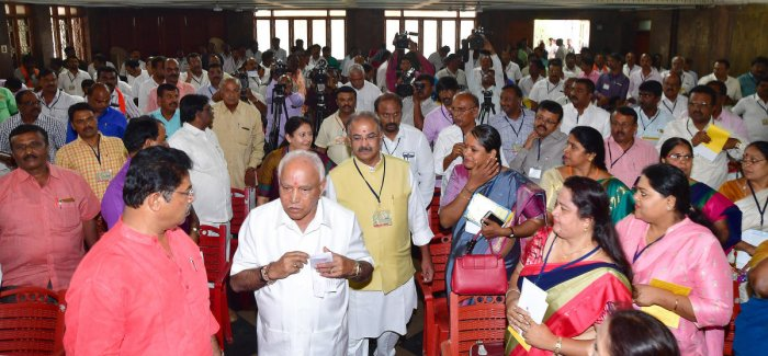 State BJP president B S Yeddyurappa arrives at the workshop for heads of 'Shakti Kendras,' held in Bengaluru on Friday. MLA R Ashoka, party election co-in-charge Kiran Maheshwari and state general secretary Arvind Limbavali are seen. DH Photo