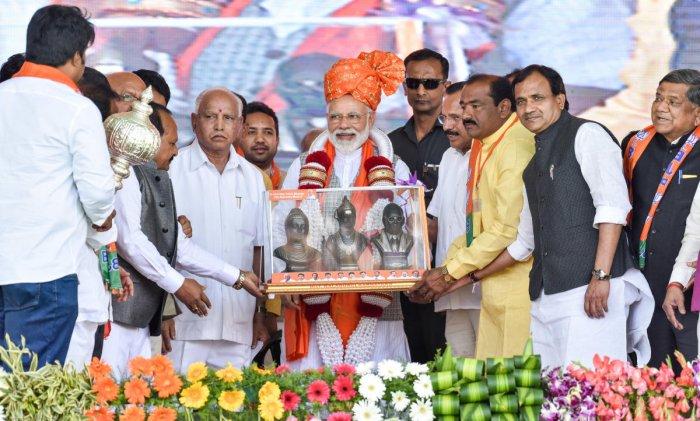 State bjp leaders felicitates to Prime Minister Narendra Modi at a public rally for the upcoming loksabha elections at NV Ground in kalaburagi on wednesday. seen - Umesh Jadhav, Former Chief Ministers B S Yeddyurappa, D V Sadananda Gowda, Doddappagouda Pa
