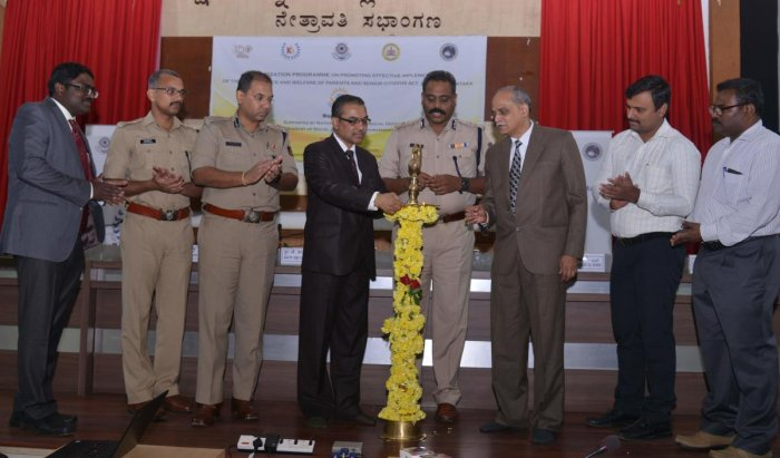 Karnataka State Legal Services Authority member secretary Hanchate Sanjeev Kumar inaugurates an awareness programme on laws relating to senior citizens organised in Mangaluru.