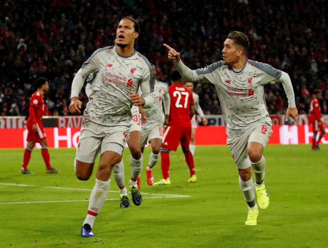 Liverpool's Virgil van Dijk (right) celebrates with team-mate Roberto Firmino after scoring against Bayern Munich in the last-16 second leg in Munich on Wednesday. Reuters