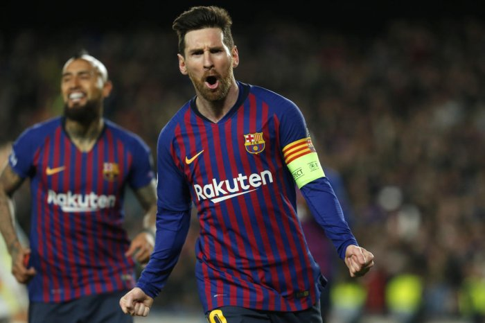 Lionel Messi celebrates after scoring against Lyon in the Champions League game against Lyon on Wednesday. AFP
