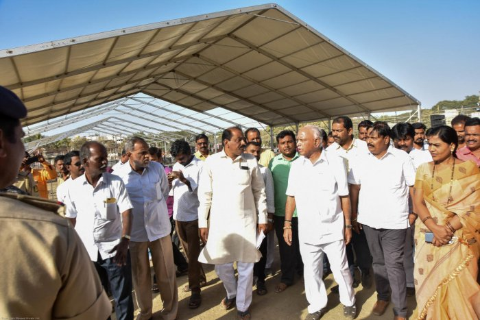 BJP State president & former chief minister B S Yeddyurappa inspects the pandal on the eve of prime minister narendra modi's public rally at n v ground in kalaburagi on tuesday. seen - BJP leaders Chandu Patil, Doddappagouda Patil Naribol, Basavaraj Mattimud and others. - Photo/ Prashanth HG