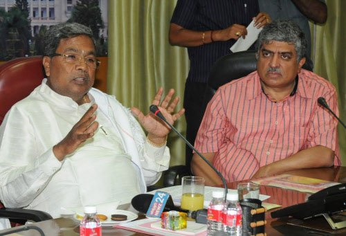 Siddaramaiah asks officials to pull up socks